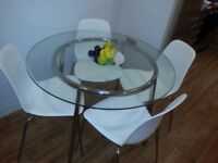 Round dining glass table with 4 chairs all bought new from IKEA.