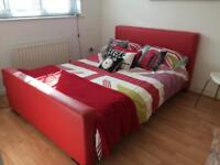 Red leather look double bed frame
