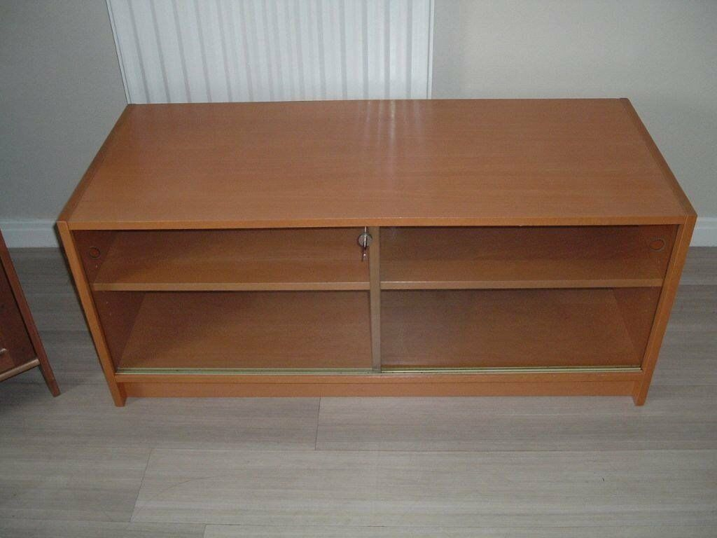 Benno TV unitin Southside, GlasgowGumtree - Benno TV unit . with 4 shelves and lockable glass sliding doors . size 1180mm wide x 500mm deep x 500mm high . dark brown wood (walnut) colour. . From smoke free clean home All in great condition Buyer To collect