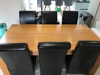 Solid oak dining table and 6 leather chairs. Good condition, cost over £900 new. Collection needed.