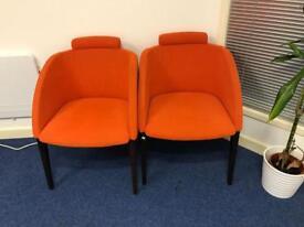 2x orange tub chairs