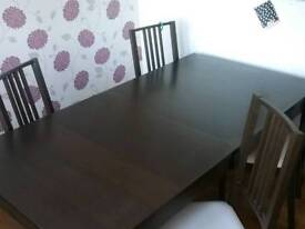 Extendable table with chairs