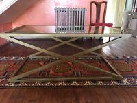 Coffee Table, very stylish, glass top set in heavy matt gold metal frame