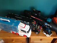 2 large trucks and submarine