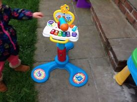 Sit and stand toy and baby pre walker