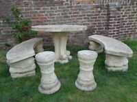 Heavy stone garden table, benches and stools