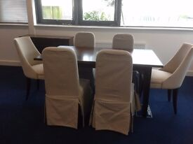 As new, Laura Ashley dining room table and 6 upholstered chairs with matching sideboard