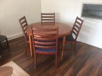 EXTENDING TABLE AND FOUR CHAIRS.