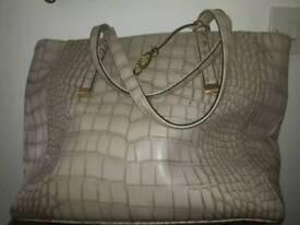 Jane Shilton beige handbag.