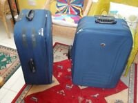 2 LARGE SUITCASES IN EXCELLENT CONDITION