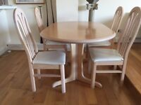 Smart dining table and four chairs in pale ash veneer finish. Barely used. Price slashed to £55!