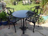 CAST IRON PEDESTAL TABLE WITH GRANITE TOP + 2 CAST ALUMINIUM CHAIRS --