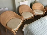 3 cushioned wicker chairs