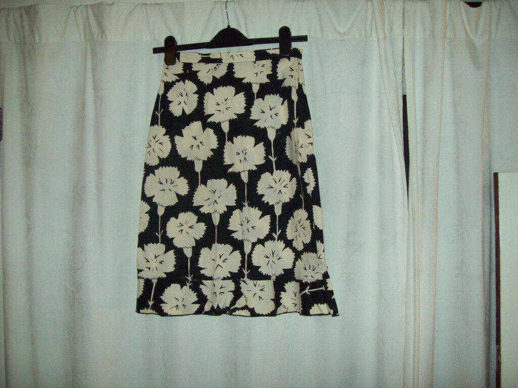 799153791a Kookai black with cream pattern knee length skirt size 36 ( small) with  frill at hemline