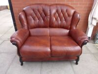 A Brown Italian Leather Chesterfield Two Seater Sofa