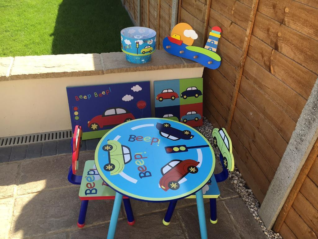 Beep beep childrens furniture setin Queenborough, KentGumtree - Lovely set originally from Dunelm. All excellent condition.Set includes table and chairs, 2 x canvas pictures, lampshade, single duvet set and coat hanger (not officially beep beep but matches perfectly)