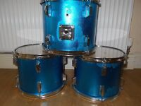 THREE METALLIC BLUE FULL SIZE TOMS ( DRUMS)