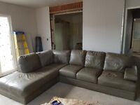 Green leather sofa. Good condition. Very comfortable.