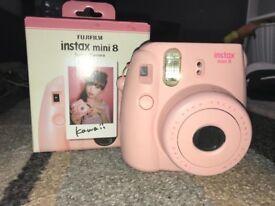 Fujifilm instax camera pink.