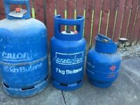 Three gas bottles open to offers