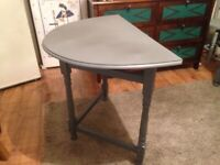 Two half moon tables