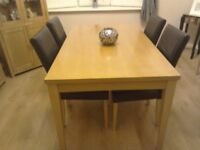 Dinning room table and 4black leather chairs.