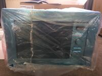 New, unused Indesit MWI1221X_SS microwave oven