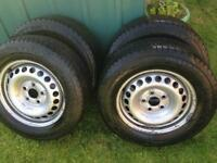 Set of four Winter tyres on wheels for a Voltswagon transporter