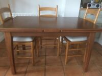 Dining table and four chairs originally bought from Marks and Spencer, in very good condition.