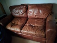 Brown leather armchair and sofa