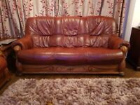 2 x 3 seater Red Leather sofas with wooden frame + Matching Footstool