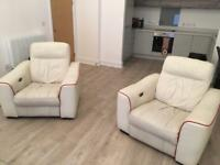 Two power reclining armchairs