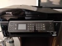 Epson Stylus SX600FW All-in-One Inkjet Printer with several replacement cartridges