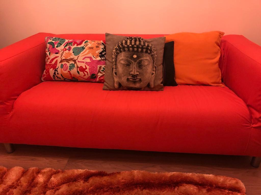 Small ikea orange sofa