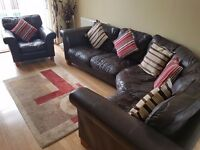 DFS leather corner sofa with matching armchair (small cushions not included)