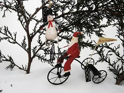 Set of 2 Christmas Tree Decorations - Santa on Tricycle & Snowman on Unicycle