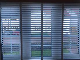 Beautiful White painted wooden blinds