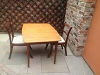 extendable dining table with 2 chairs