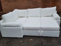 Lovely BRAND NEW white faux leather corner sofa bed with storage.delivery available