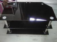 Black glass and chrome TV stand (need gone)