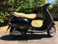 Low mileage stylish Vespa Piaggio Scooter LX50 - looks great in black and beige