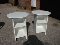 A PAIR OF MATCHING MELAMINE WHITE BEDSIDE CABINETS WITH CIRCULAR TOPS