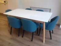 Frosted glass top dining table with 6 Alec dining chairs from 'Made' in mineral blue