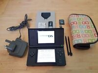 Nintendo DS Lite with carry case, original charger, 2 stylus and DS One Supercard Bundle