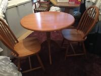 Pine circular table and two chairs