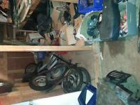 large lot of motorcycle atv and snowmobile parts