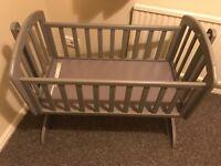 Sophie's swinging baby crib