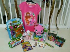 Collection of brand new moshi monster merchandise including rucksack and talking poppet