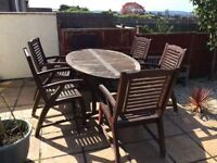 Hard wood garden extendable table and 6 chairs with parasol