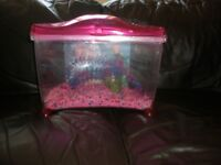plastic fish tank includes gravel/plastic plants